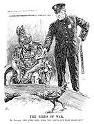"""The Birds of War. Mr Kellogg. """"See here now, Mars, you gotta cut that right out."""" [US policeman Frank Kellogg with Peace Pact baton refuses to quell the fighting cocks as the God of War looks at him disdainfully]"""
