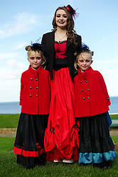 © Licensed to London News Pictures. <br /> 01/11/2014. <br /> <br /> Whitby, Yorkshire, United Kingdom<br /> <br /> Sisters Shelley (L), 7, Leigha, 14, and Jodie (7) Webster form Hartlepool pose for a picture during the Whitby Goth Weekend. <br /> <br /> The event this weekend brings together thousands of extravagantly dressed followers of Victoriana, Steampunk, Cybergoth and Romanticism who all visit the town to take part in celebrating Gothic culture. This weekend marks the 20th anniversary since the event was started by local woman Jo Hampshire.<br /> <br /> Photo credit : Ian Forsyth/LNP