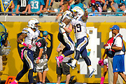 San Diego Chargers running back Ryan Mathews (24) celebrates with running back Danny Woodhead (39) after scoring during an NFL game against the Jacksonville Jaguars at EverBank Field on Oct. 20, 2013 in Jacksonville, Florida. San Diego won 24-6.<br /> <br /> ©2013 Scott A. Miller