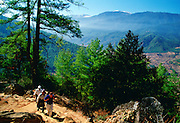 Tourist and locals trekking in Bhutan