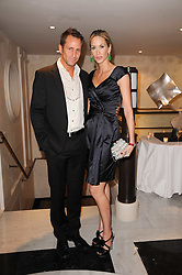 LISA BUTCHER and JEREMY SHEFFIELD at a dinner hosted by jewellers Damiani at The Connaught Hotel, London on 3rd February 2010.