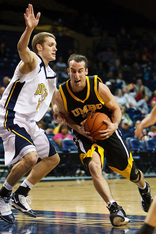 5 December 2009:  Toledo's Jake Barnett (30) and UMBC's Matt Spadafora (21) during the NCAA basketball game between UMBC Retrievers and the Toledo Rockets at Savage Arena in Toledo, OH.