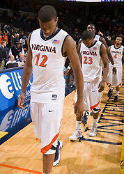 Virginia forward Jamil Tucker (12) and guard Jeff Jones (23) react after losing to Auburn.  The Auburn Tigers defeated the Virginia Cavaliers 58-56 at the University of Virginia's John Paul Jones Arena  in Charlottesville, VA on December 20, 2008.  (Special to the Daily Progress / Jason O. Watson)