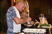 Chef and Nutritionist Michael Scipione demonstrates a healty preparation of New York Strip Steak at the Grand Market during the Atlantic City Food & Wine Festival