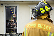 Spring Valley Fire Department fire fighters work to contain and extinguish a structure fire at the 3000 block of Calaveras Road near Spring Valley Golf Course in Milpitas, California, on February 10, 2014. (Stan Olszewski/SOSKIphoto)