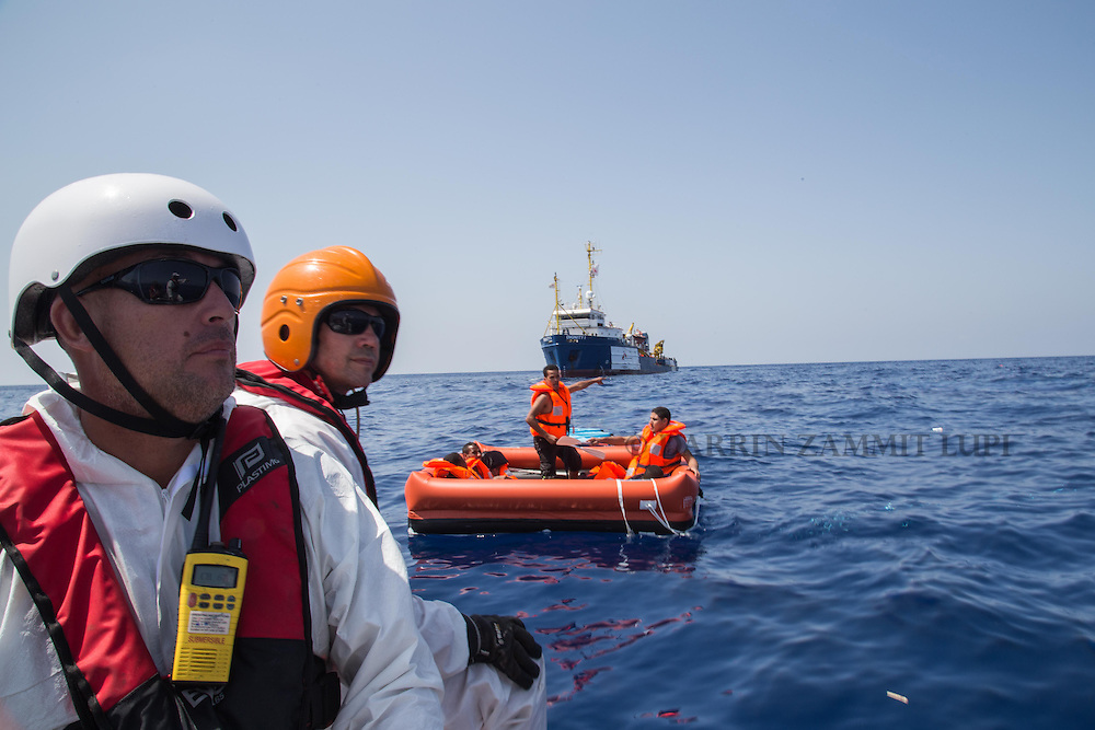 A zodiac crew from MSF's  Dignity I search and rescue vessel scan the sea for survivors in the area where a wooden boat carrying migrants capsized and sank off the coast of Libya August 5, 2015.<br /> A boat packed with up to 700 African migrants capsized in the Mediterranean Sea off the coast of Libya on Wednesday and many were feared dead, officials and aid agencies said. <br /> REUTERS/Marta Soszynska/MSF/ Handout<br /> NO ARCHIVE. NO COMMERCIAL USE. NO SALES