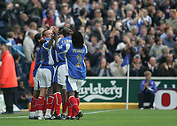 Photo: Lee Earle.<br /> Portsmouth v Reading. The Barclays Premiership. 28/10/2006. Portsmouth's Kanu is congratulated after his help towards their first goal.