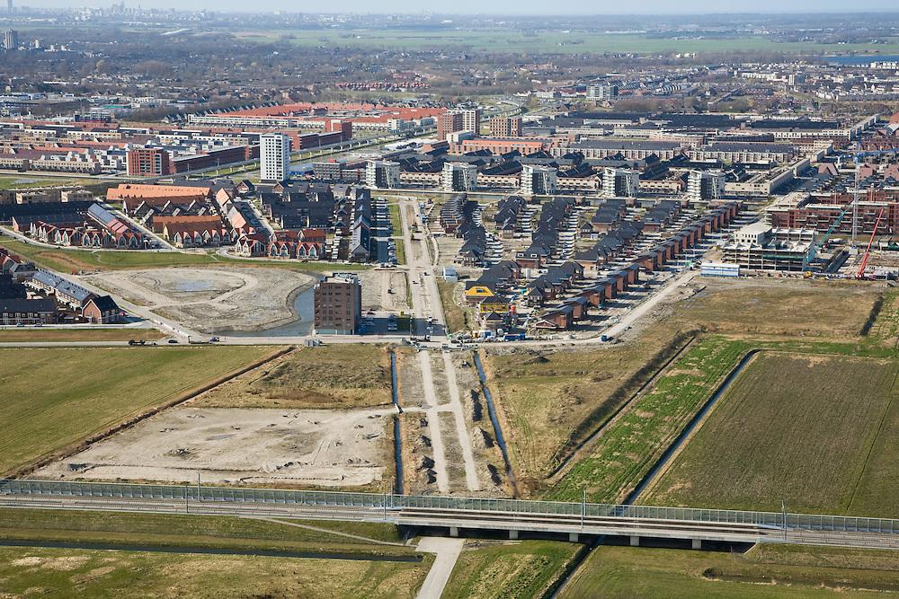 Nederland, Zuid-Holland, Zoetermeer, 04-03-2008; nieuwbouw in de VINEX-wijk Oosterheem, in de voorgrond de Hogesnelheidslijn (HSL); .Vinex, Vinexlokatie, wonen, woningbouw, stadsuitbreiding, eengezinswoingen, spoorlijn, . .luchtfoto (toeslag); aerial photo (additional fee required); .foto Siebe Swart / photo Siebe Swart.