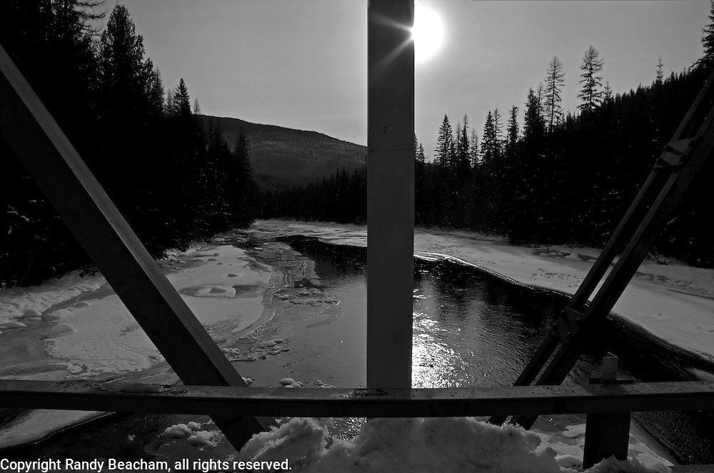 Seventeen Mile Bridge and Sun on the Yaak River. Yaak Valley in the Purcell Montains, northwest Montana