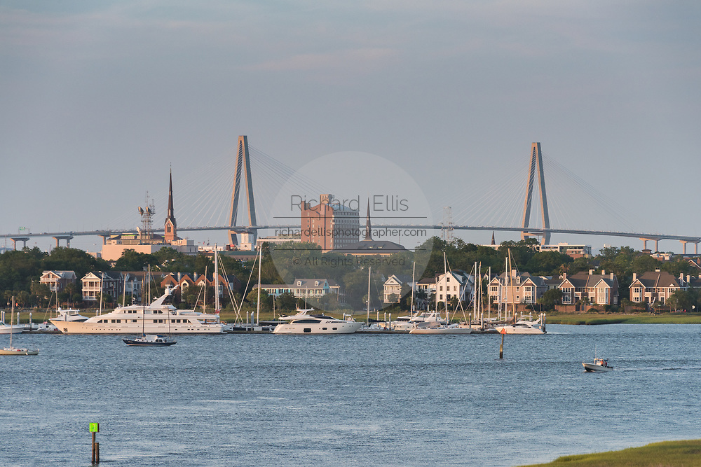 Arthur Ravenel Jr. Bridge and city skyline along the Ashley River at sunset in Charleston, South Carolina.