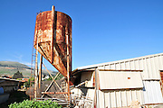 Israel, Galilee, a chicken coop with feeding silo on a Moshav
