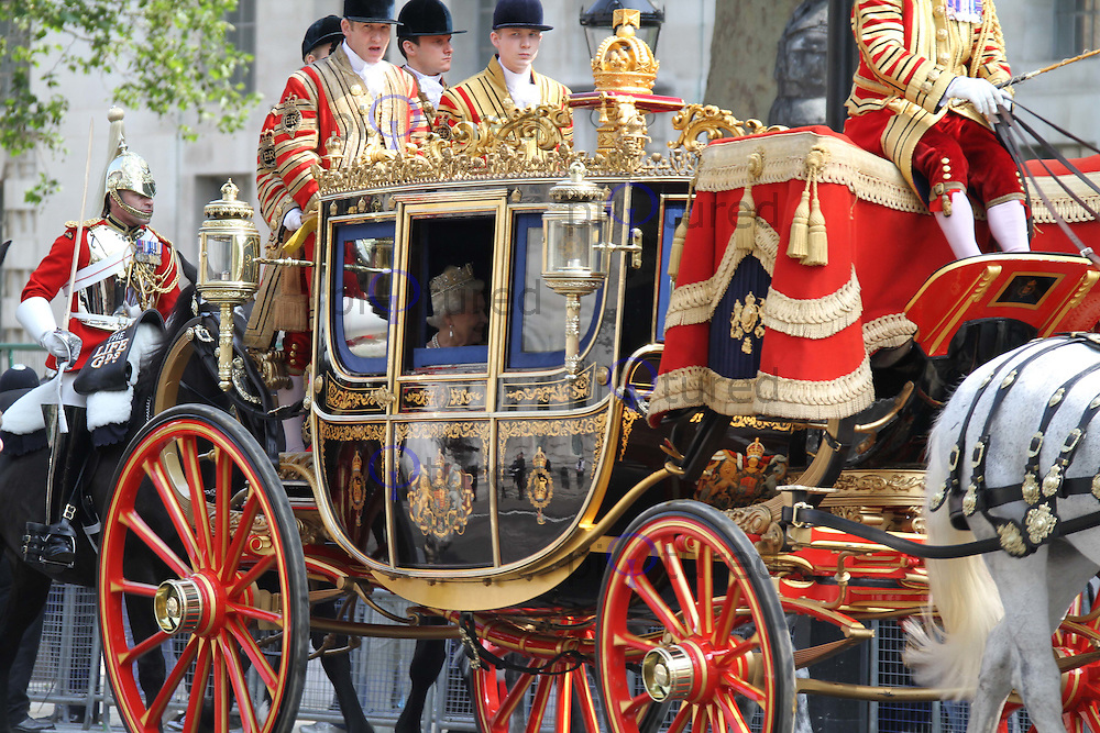 Queen Elizabeth London, UK, 25 May 2010: The State Opening of Parliament Royal Procession in Whitehall. For piQtured Sales contact: Ian@Piqtured.com +44(0)791 626 2580 (Picture by Richard Goldschmidt/Piqtured)