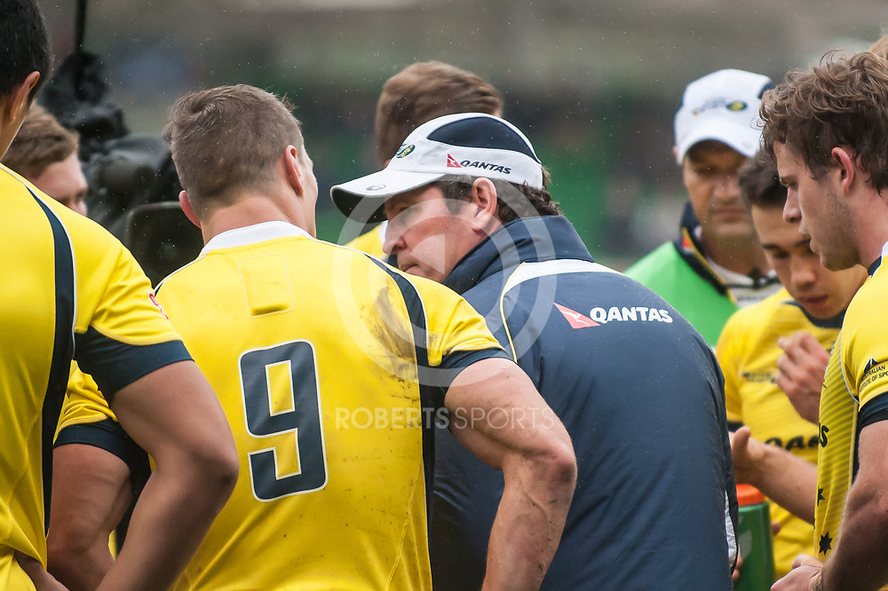 Departing Australia coach Michael O'Connor talks to his players at half-time. Action from the IRB Emirates Airline Glasgow 7s at Scotstoun in Glasgow. 4 May 2014. (c) Paul J Roberts / Sportpix.org.uk