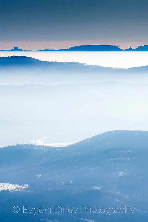 Mountain lines deep in the winter haze