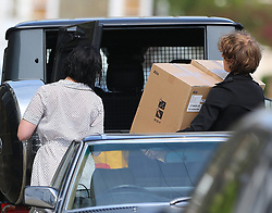 (EXCLUSIVE PICTURES) Model Daisy Lowe nearly has a Marilyn Monroe moment as she steps out of her Mercedes-Benz G-Class AMG. Daisy wearing a white polka-dot dress and pair of black boots lets her boyfriend Cameron McMeikan carry two large boxes from Habitat they arrive home after shopping trip... London, UK. 18/04/2019<br />