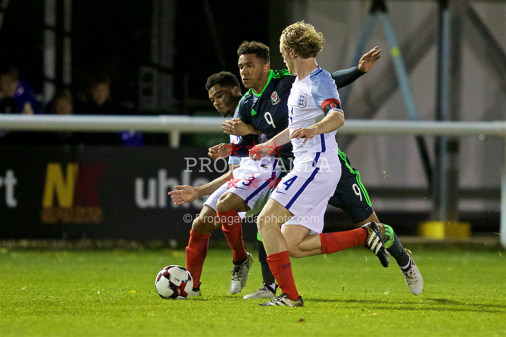 BANGOR, WALES - Saturday, November 12, 2016: Wales' captain Tyler Roberts in action against England's Jay DaSilva and captain Tom Davies during the UEFA European Under-19 Championship Qualifying Round Group 6 match at the Nantporth Stadium. (Pic by Gavin Trafford/Propaganda)