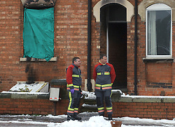 (c) London News Pictures. 04-12-2010. Firemen stand outside the scene of a house fire in Newark-On-Trent today (Saturday).The scene of a house fire in Newark-On-Trent today (Saturday). Officers were called to the house at approximately 3:30pm yesterday evening, and the body of a lady who is yet to be identified by police was found at the scene. Picture credit should read: Tim Goode/London News Pictures