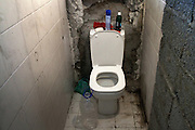 A makeshift toilet in a house in Bab Al Aziziya. Hundreds of families displaced by the war and not more able to pay a rent found shelter in the buildings not completely demolished in Bab Al Aziziya, the Kaddafi stronghold and symbol of the regime in center Tripoli.