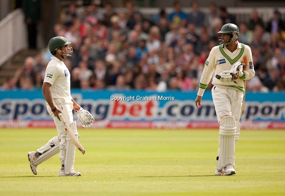 Umar Akmal and Mohammad Asif (right) walk off after losing the final npower Test Match between England and Pakistan at Lord's amidst the match fixing scandal.  Photo: Graham Morris (Tel: +44(0)20 8969 4192 Email: sales@cricketpix.com) 29/08/10