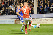 John Terry clears the ball from Jason Demetriou during the Capital One Cup match between Walsall and Chelsea at the Banks's Stadium, Walsall, England on 23 September 2015. Photo by Alan Franklin.