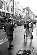 Dean Spencer, Neville Watson and Scottish Piper, Oxford Street, London. 1980s.