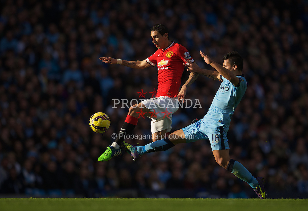 MANCHESTER, ENGLAND - Sunday, November 2, 2014: Manchester United's Angel Di Maria and Manchester City's Sergio Aguero during the Premier League match at the City of Manchester Stadium. (Pic by David Rawcliffe/Propaganda)