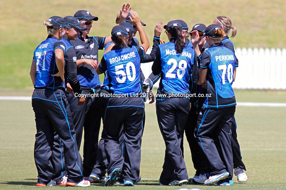 The White Ferns celebrate the dismissal of England's Lauren Winfield. 1st one day international, womens cricket match at Bay Oval, Mt Maunganui, 11 February 2015. Copyright Photo: Margot Butcher / www.photosport.co.nz