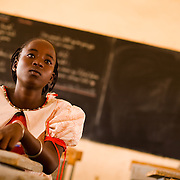 "Adjatou Traoré, 13, attends class at the Petit Paris primary school in the town of Dori, 240 km northeast of Burkina Faso's capital Ouagadougou on Monday May 11, 2009. When she was 12, Adjatou's mother attempted to sell her to a Ghanaian man who was trying to find his son a wife. She refused the marry the man. ""Early marriage is not a good thing,"" she says, ""because a child should never have to give up school."""