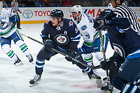 PENTICTON, CANADA - SEPTEMBER 8: Jansen Harkins #58 of Winnipeg Jets is checked by Danny Moynihan #79 of Vancouver Canucks on September 8, 2017 at the South Okanagan Event Centre in Penticton, British Columbia, Canada.  (Photo by Marissa Baecker/Shoot the Breeze)  *** Local Caption ***