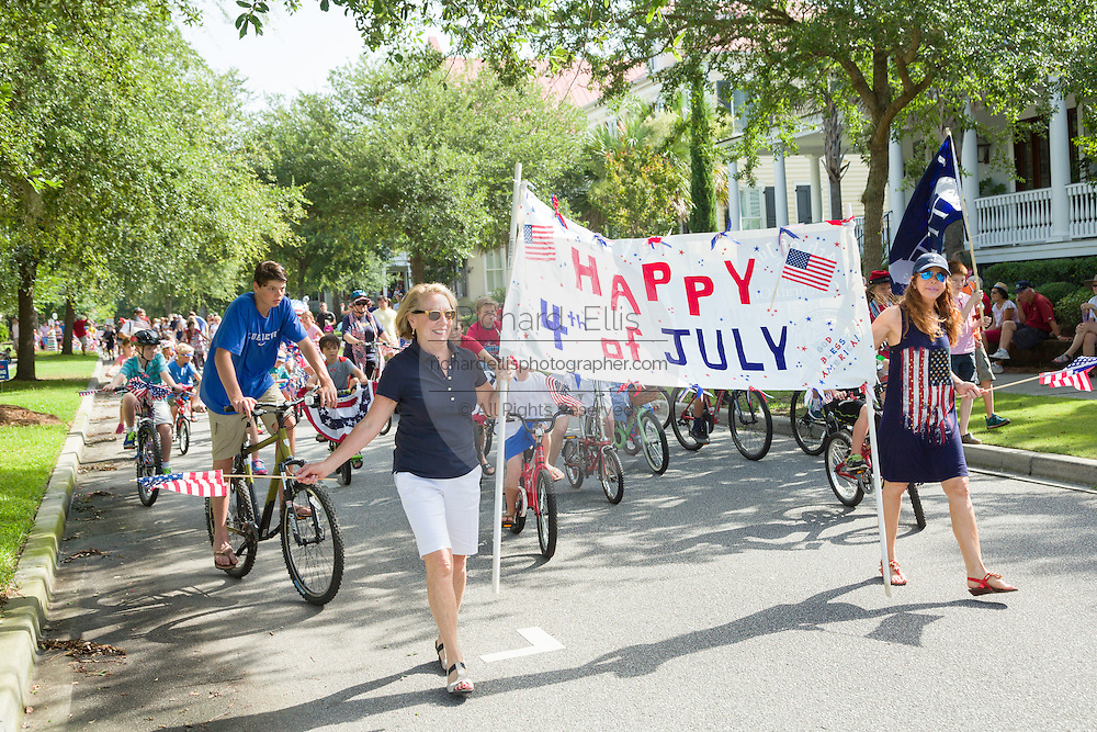 Decorated bicyclists ride past homes during the I'On neighborhood Independence Day parade July 4, 2015 in Mt Pleasant, South Carolina.
