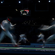 Jun Zhu, China, (left) in action against Byungchul Choi, Korea, (foreground) and Guilherme Toldo, Brazil and Race Imboden, USA, in action in the Men's Foil Individual event during the Fencing competition at ExCel South Hall during the London 2012 Olympic games. London, UK. 31st July 2012. Photo Tim Clayton