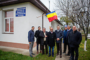 Group image with non Roma mayor Manole Aurelian (middle) in front of the polling station (school) in Marginenii de Jos. From left Roma activist Marius Tudor, Dumitru Nica Florin (local Roma councilor), Ilie Dumitru (ex  local Roma councilor and the founder of the Roma adventist church), Negoi Mirel (local Roma councilor), mayor Aurelian, Moraru Nicolae (non roma local councilor), activist Gheorghe Tudor and Radu Ionescu (county councilor).