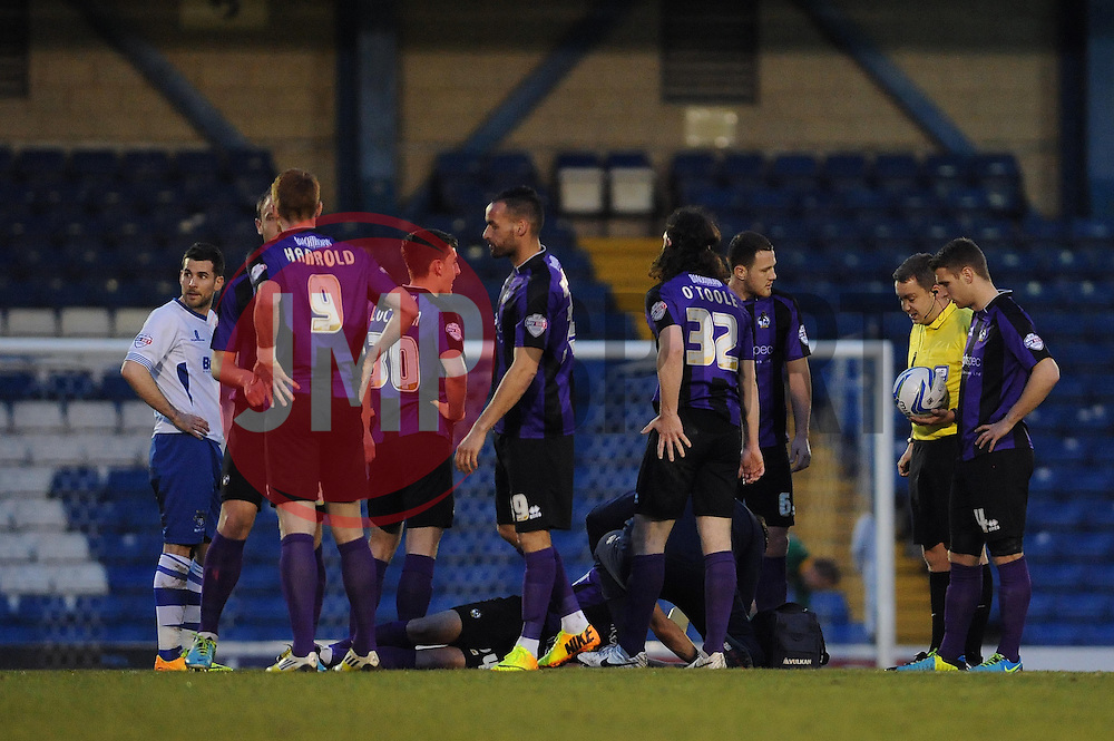 Bristol Rovers' Ollie Clarke receives treatment - Photo mandatory by-line: Dougie Allward/JMP - Mobile: 07966 386802 01/04/2014 - SPORT - FOOTBALL - Bury - Gigg Lane - Bury v Bristol Rovers - Sky Bet League Two