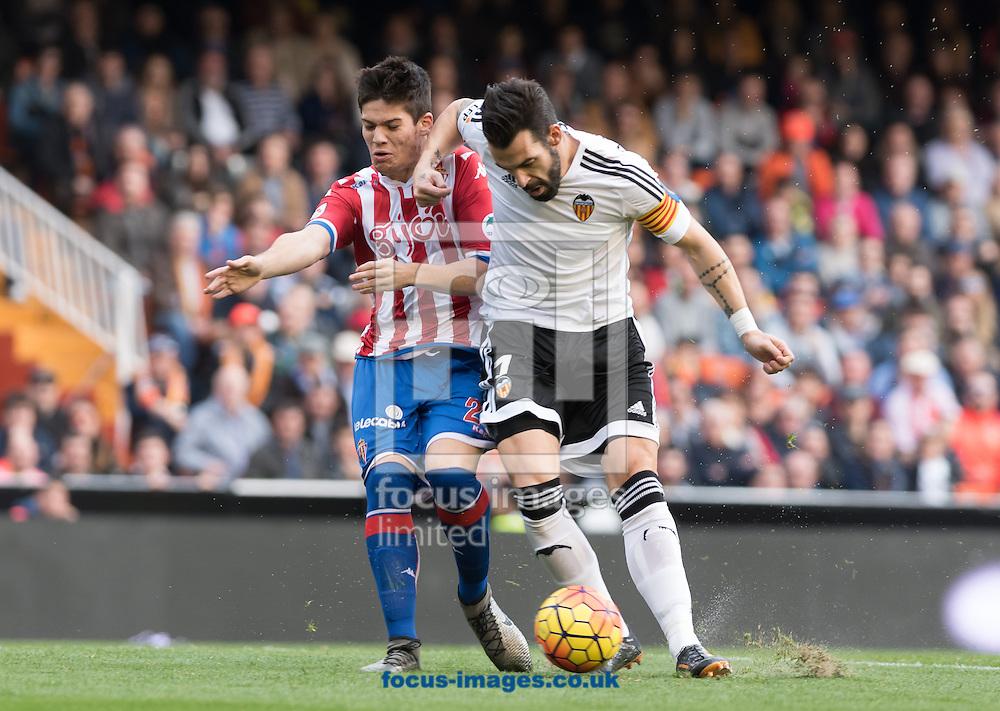 Alvaro of Valencia Club de F&uacute;tbol and Luis Hernandez of Real Sporting de Gij&oacute;n during the La Liga match at Mestalla, Valencia<br /> Picture by Maria Jose Segovia/Focus Images Ltd +34 660052291<br /> 31/01/2016