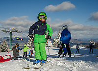 Xavier Corbin stands at the top of Ragged Mountain after riding the Summit Six Express to begin his vacation week race training Tuesday morning.  (Karen Bobotas/for the Laconia Daily Sun)