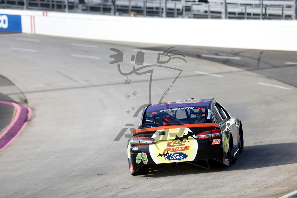 Matt DiBenedetto (32) races through turn three to practice  for the First Data 500 at Martinsville Speedway in Martinsville, Virginia.