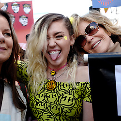 Singer Miley Cyrus, center, with actress and activist Jane Fonda during Women's March Los Angeles, a national movement to unify and empower everyone who stands for women's rights, human rights, civil liberties, and social justice for all, the march begun at Pershing Square  and marched along Hill and Broadway to City hall on Saturday, Jan. 21, 2017 in Los Angeles.