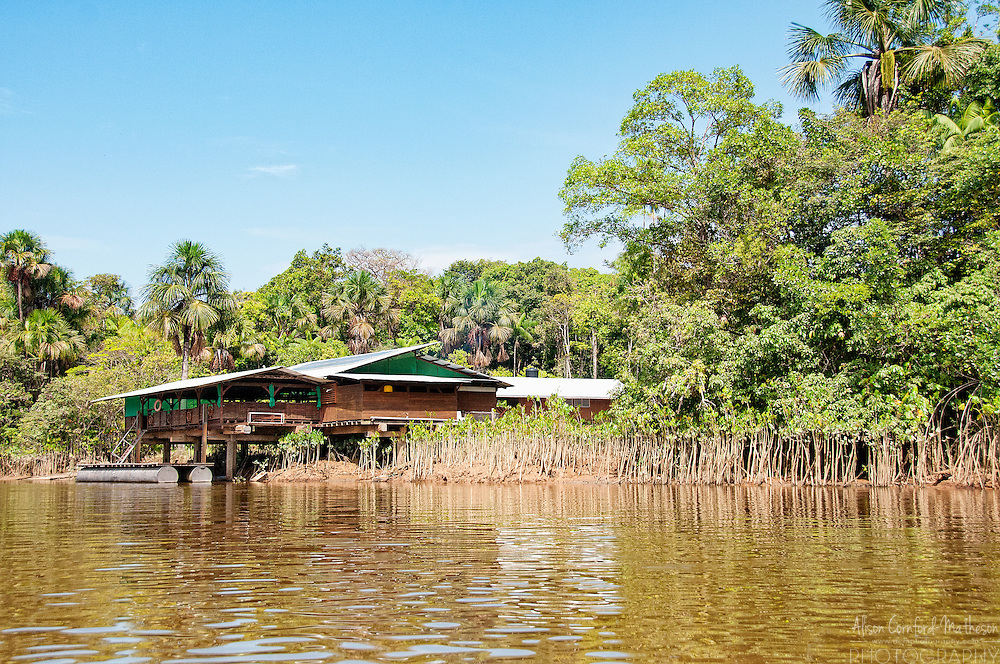 Navigating the rivers and criques of French Guiana by a traditional wooden boat, or pirogue, with Waki Village.