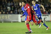 George Francomb and Nathaniel Mendez-Laing chase the ball during the EFL Sky Bet League 1 match between AFC Wimbledon and Rochdale at the Cherry Red Records Stadium, Kingston, England on 28 March 2017. Photo by Daniel Youngs.