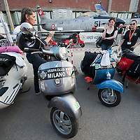MILAN, ITALY - JUNE 05:  Women riders prepare for the start of the Vespa race on June 5, 2010 in Milan, Italy. Vespa is one of the best known Italian icons, the special Vespa week end is the XV edition of the famous  500km night race  (Photo by Marco Secchi/Getty Images)