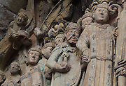 Abbot Begon with his crosier, leading Emperor Charlemagne by the hand, from the procession of the chosen ones, early 12th century Romanesque, carved by the Master of the Tympanum, from the tympanum of the Last Judgement above the portal on the West facade of the Abbatiale Sainte-Foy de Conques or Abbey-church of Saint-Foy, Conques, Aveyron, Midi-Pyrenees, France, a Romanesque abbey church begun 1050 under abbot Odolric to house the remains of St Foy, a 4th century female martyr. Also in the procession are Dadon, Begon and Charlemagne, historical figures with links to the Sainte-Foy. The church is on the pilgrimage route to Santiago da Compostela, and is listed as a historic monument and a UNESCO World Heritage Site. Picture by Manuel Cohen