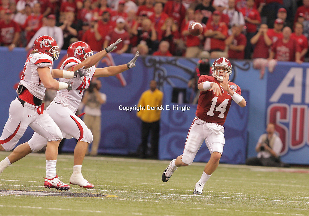 2 January 2009: Alabama quarterback John Parker Wilson (14) throws a pass as he scrambles away from pressure during the 75th annual All State Sugar Bowl  between the Utah Utes and the Alabama Crimson Tide at the Louisiana Superdome in New Orleans, LA.
