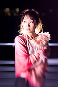 Outdoor night portraits of a young Japanese lady in Osaka, taken with a selective focus lens.