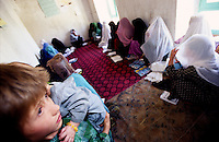YAFTAL PAYAN, 31 July 2005..Women at Bitha Bala's Vocational Traning Centre.  ..Most of the 'one room' school are located in private houses. The VTC aim is to make women aware of their onwn status as Mother and as Woman, by giving lessons on maternity, health, family planning and post-natal issues. ....According to United Nations Population Fund, Afghanistan has among the world?s highest rates of maternal mortality, and Badakhshan has the highest rates ever recorded anywhere in the world, with one mother dying in every 15 births. Underage marriage is one of the primary causes of maternal mortality.....The VTC is funded by UNFPA and implemented by IBNSINA.