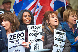 &copy; Licensed to London News Pictures. 08/04/2018. LONDON, UK. Campaign Against Antisemitism hold a demonstration outside the Labour Party HQ. The group accuse Jeremy Corbyn (not pictured) of bringing the party into 'disrepute' for 'dismissing and endorsing' anti-semitic views.  Photo credit: Cliff Hide/LNP<br /> <br /> Campaign Against Antisemitism hold a rally protesting the Labour Party's rejection of the group's disciplinary complaint made against leader Jeremy Corbyn, which accuses him of bringing the party into 'disrepute' for 'dismissing and endorsing' anti-semitic views. The complaint also criticises Corbyn for his defence of an anti-Semitic mural in London that had already been earmarked for removal by Tower Hamlets Council, and for his membership of the 'Palestine Live' Facebook group