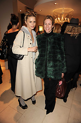 Left to right, LAURA BAILEY and SIDNEY FINCH at a party for TACH jewellery held at Tach, 13 Grafton Street, London on 10th December 2009.