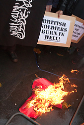 © under license to London News Pictures. 13/12/2010 Two suspected members of Muslims Against Crusades have been charged after allegedly burning poppies on Armistice Day, 11/11/2010. The large poppy was burned during the two minutes' silence, as protesters carried a variety of placards in opposition to British soldiers