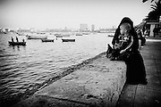 Veiled woman with her son by the Corniche, Alexandria, Egypt 2010