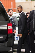 Superstar Pharrell Williams walks to his car after performing with the Gospel Choir during Sunday service at the historic Mother Emanuel AME Church November 1, 2015 in Charleston, South Carolina. The church was the site of the mass shooting that killed nine-people in June 2015 and will be featured is part of a program on race relations being produced by A+E Networks.