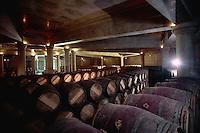 June 1989, Ch?teau Lafite Rothschild, Pauillac, Bordeaux region, France --- Stacks of wine casks fill a wine cellar at the Ch?teau Lafite Rothschild in Pauillac, Bordeaux, France. --- Image by © Owen Franken/CORBIS